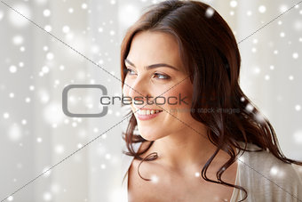 close up of happy woman looking through window