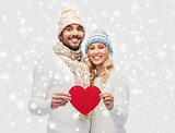 smiling couple in winter clothes with red heart