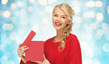 happy smiling woman in red dress with gift box