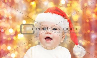 baby boy in christmas santa hat