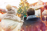 close up of couple in old town at christmas