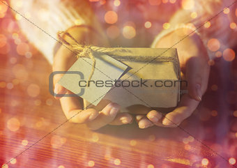 close up of woman hands with christmas gift