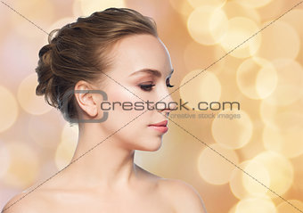 beautiful young woman face over holidays lights