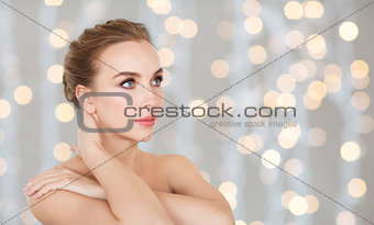 beautiful young woman over holidays lights