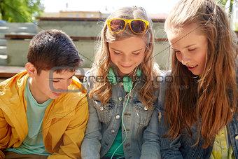 three happy teenage friends headphones