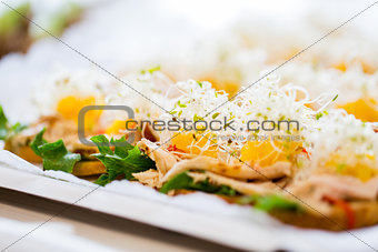 close up of canape or sandwiches on serving tray