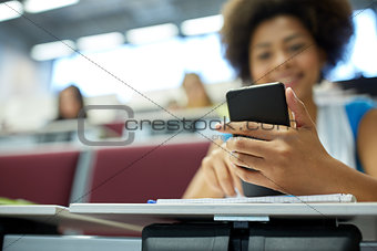 close up of african student with smartphone