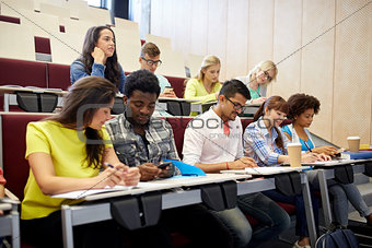group of students with smartphone at lecture
