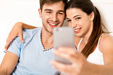 Couple on bed making selfies