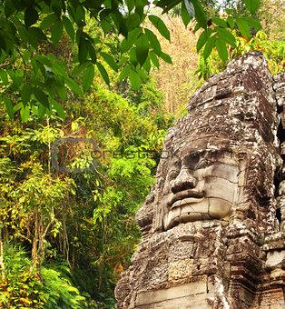 Giant stone face in Prasat Bayon Temple, Angkor Wat, Cambodia