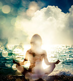 Woman Practicing Yoga by the Sea. Bokeh Background