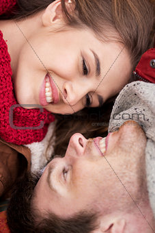 close up of happy smiling young couple faces