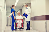 medics and senior woman in wheelchair at hospital