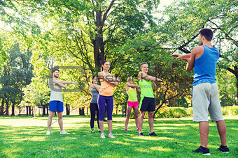 group of friends or sportsmen exercising outdoors