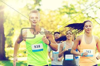 happ young sportsmen racing wit badge numbers