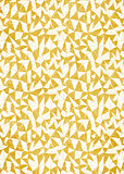 Gold foil decorative background with abstract geometric triangle pattern.