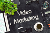Video Marketing Concept on Black Chalkboard. 3D Rendering.
