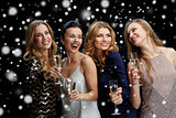 happy women with champagne glasses over black