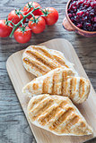 Grilled chicken with cranberry sauce and fresh cherry tomatoes