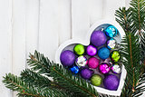 Ð¡hristmas card with wooden heart, balls, decoration and fir-tre