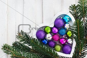 Ð¡hristmas card with wooden heart, balls, decoration and fir-tre