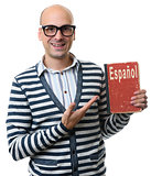 handsome guy holds a textbook. learning spanish concept