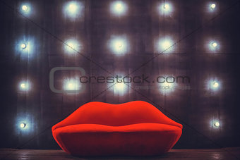 Beautiful luxury red lips sofa on grey background with lights