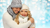 happy family couple in winter clothes hugging