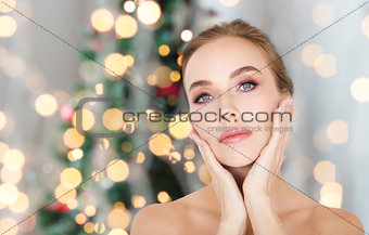 beautiful woman face over christmas lights