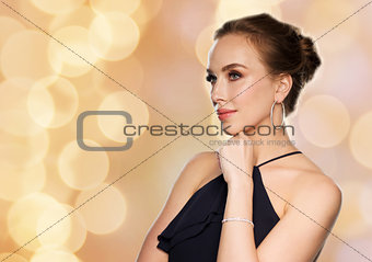 beautiful woman in diamond jewelry over lights
