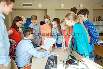 group of students and teacher at school classroom