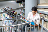 hindu student boy or man reading book at library