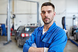 auto mechanic man or smith at car workshop