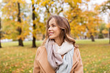 beautiful happy young woman smiling in autumn park