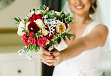 Bride with a bouquet of rose in the hands.