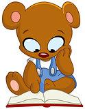 Teddy bear reading book