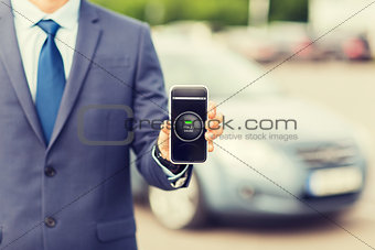 close up of business man with smartphone app