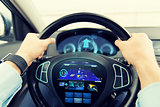 close up of man driving car with gps navigator