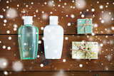 handmade soap bars and lotion bottles on wood