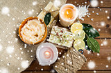 natural soap and candles on wood