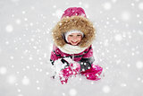 f happy little child or girl with snow in winter