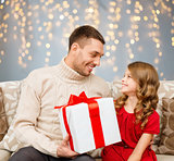 smiling father and daughter with christmas gift