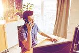 happy creative male worker calling on smarphone
