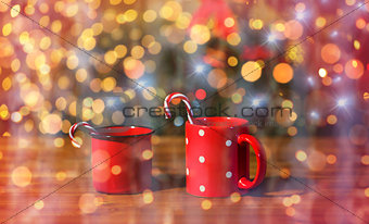 christmas candy canes in cups on wooden table