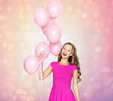 happy young woman or teen girl with balloons
