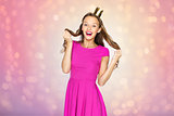 happy young woman or teen girl in princess crown