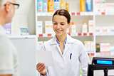 pharmacist reading prescription and senior man