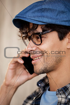 close up of hipster man calling on smartphone