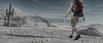 Tourist backpacking through desert.