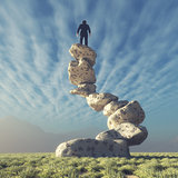 Silhouette of a man on top of rocks
